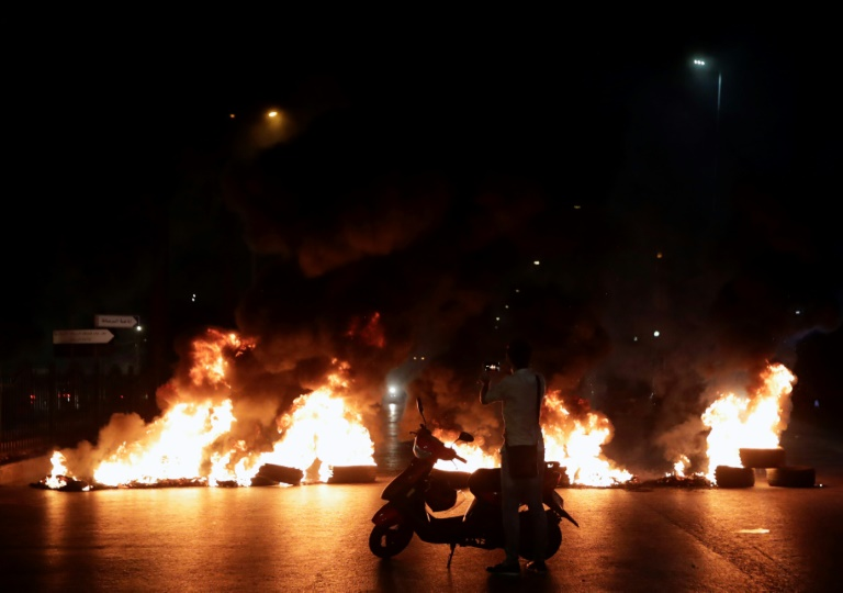 Protesters burned tyres as hundreds of people took to the streets in anger over a move to tax calls on messaging apps