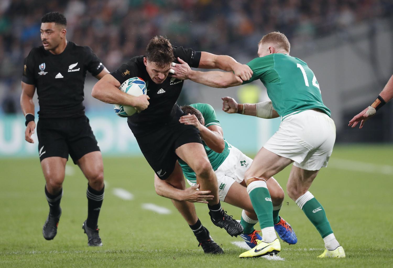New Zealand's George Bridge fends off Ireland's Jordan Larmour during their quarter-final match on Saturday at Tokyo Stadium. (Reuters Photo)