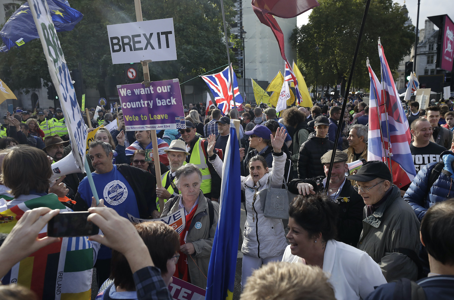 A small group of Brexit supporters mingle with anti-Brexit demonstrators in Parliament Square in London, where Parliament was holding its first Saturday sitting in 37 years to debate the country's exit from the EU. (AP Photo)