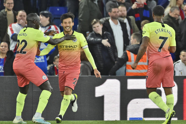Manchester City's David Silva celebrates after scoring his side second goal during the English Premier League soccer match at Selhurst Park in London on Saturday. (AP photo)