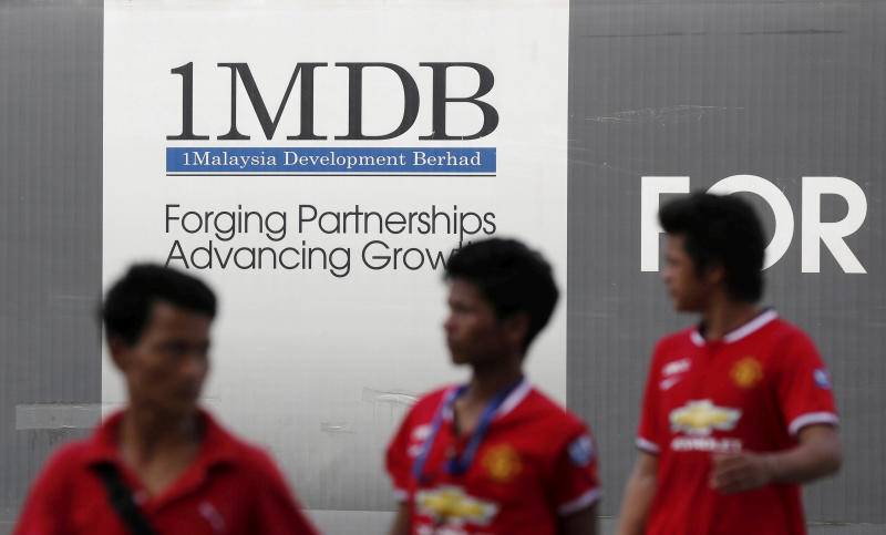 Men walk past a 1Malaysia Development Berhad (1MDB) billboard at the fund's flagship Tun Razak Exchange development in Kuala Lumpur March 1, 2015. (Reuters file photo)