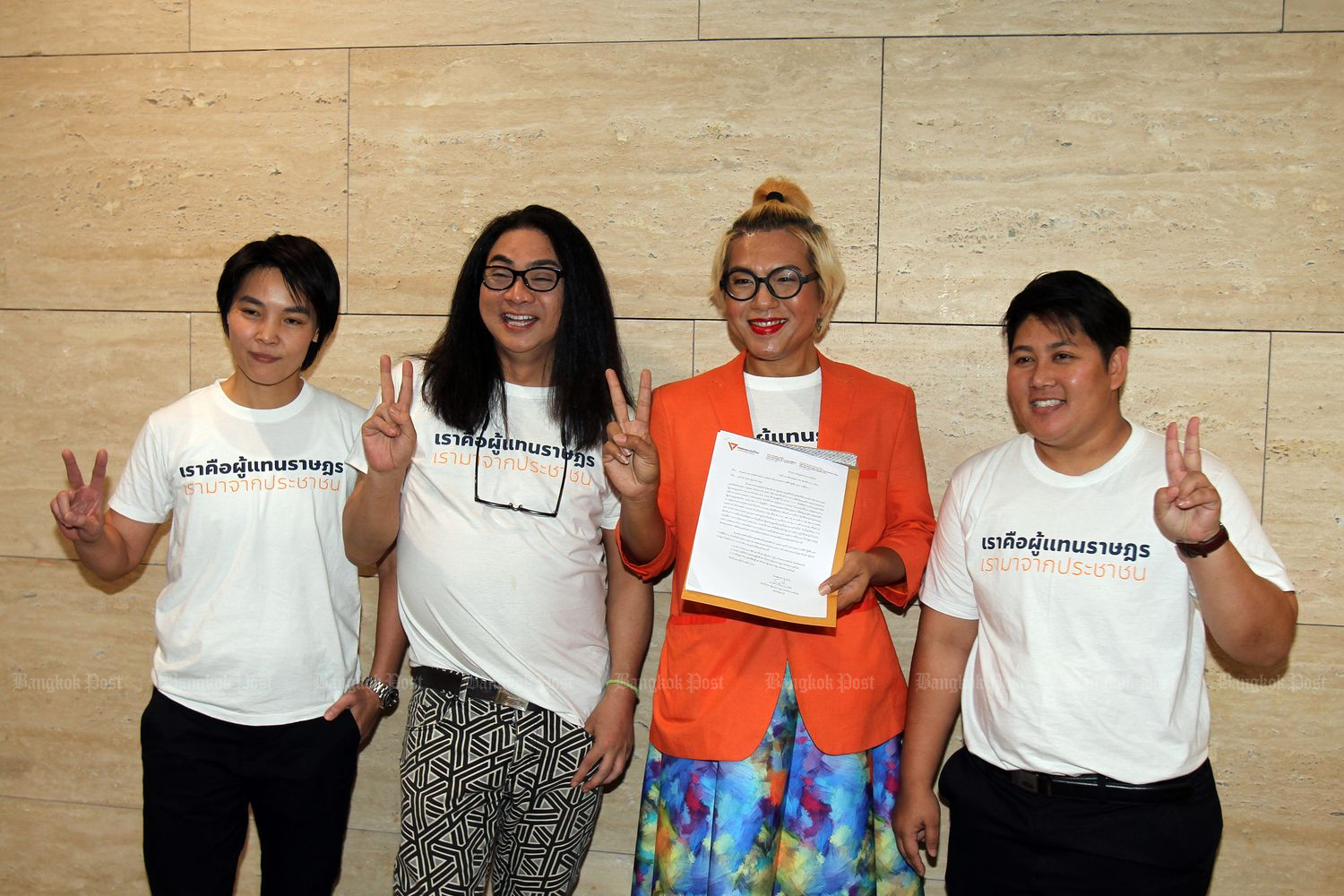 In this May 13 file photo, Kawinnath Takey (right) joins other LGBT MPs of the Future Forward Party — (from left) Nateepat Kulsetthasith,Tunyawaj Kamolwongwat, Tanwarin Sukkhapisit) — in submitting a letter to the House speaker seeking a permission to dress according to their gender identity at Parliament in Bangkok. (Photo by Tawatchai Kemgumnerd)
