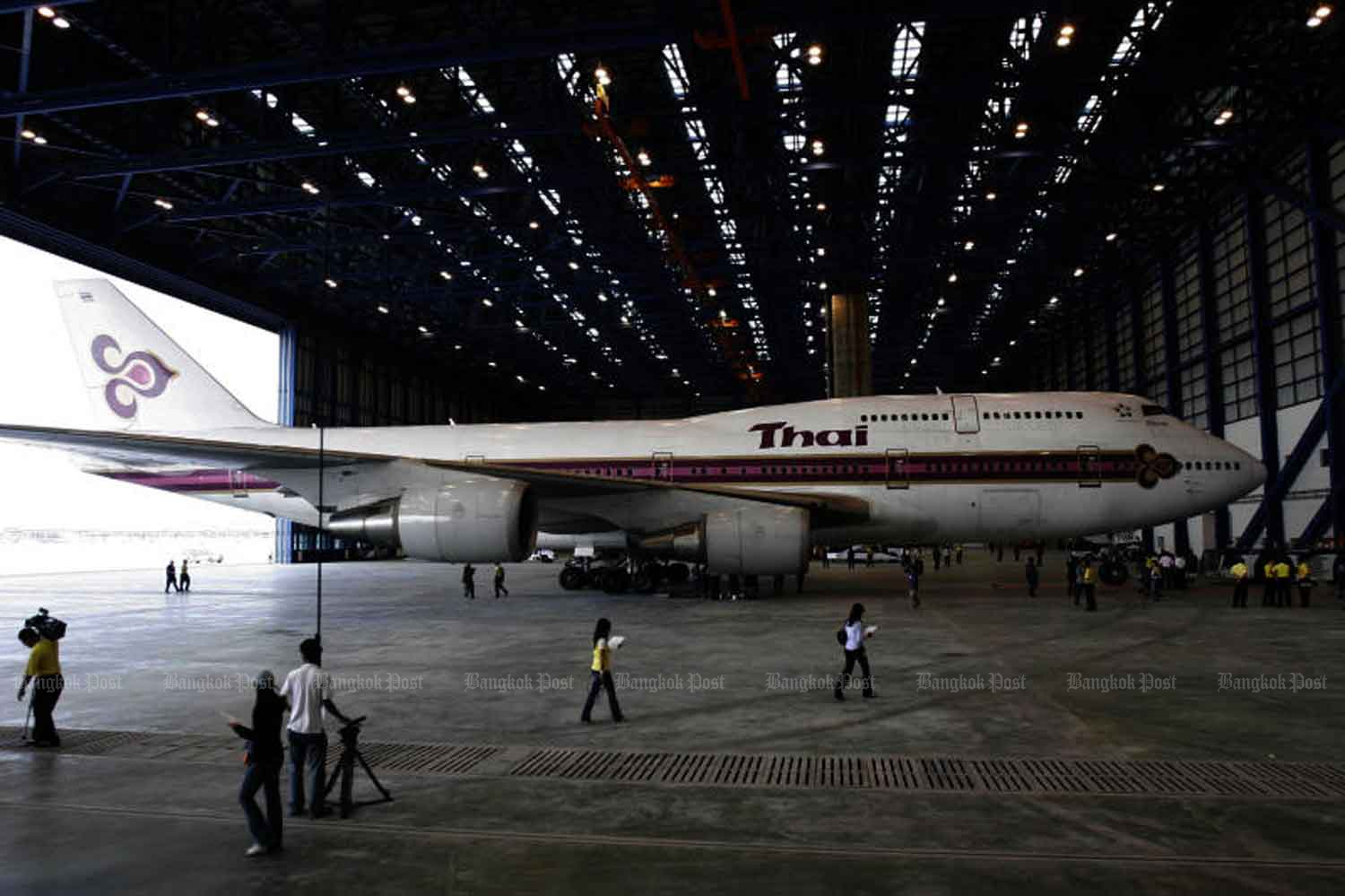 A Thai Airways International plane is seen at Suvarnabhumi airport's maintenance centre in Samut Prakan province. The airline's president on Tuesday voiced serious concern about the loss-ridden national airline's future and cited this aircraft waiting for repairs as an example of why it was losing so much money. (Bangkok Post file photo)