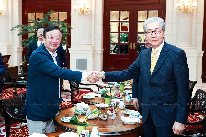 Deputy Prime Minister Somkid Jatusripitak meets Ren Zhengfei, Huawei's founder, in China.