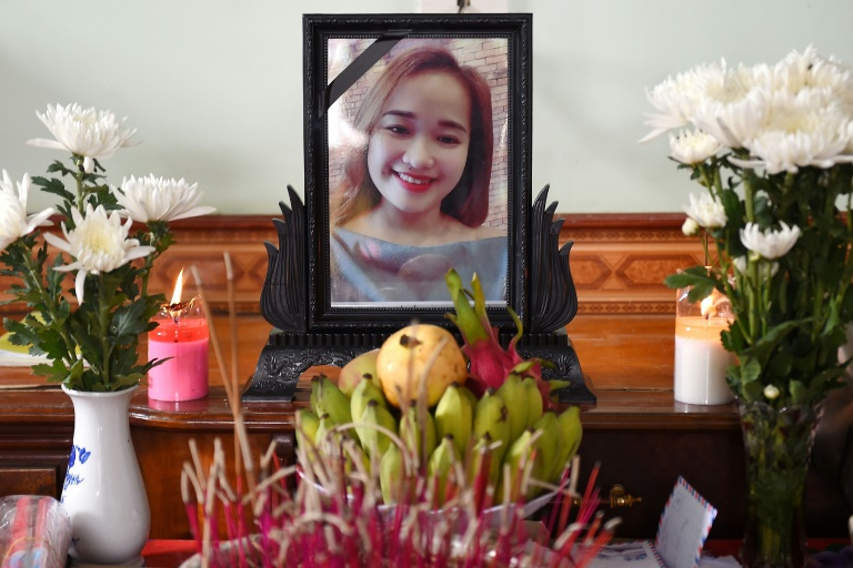 A portrait of Bui Thi Nhung, feared among the 39 people found dead in a truck in Britain, is displayed on an a makeshift altar at her home in Vietnam's Nghe An province
