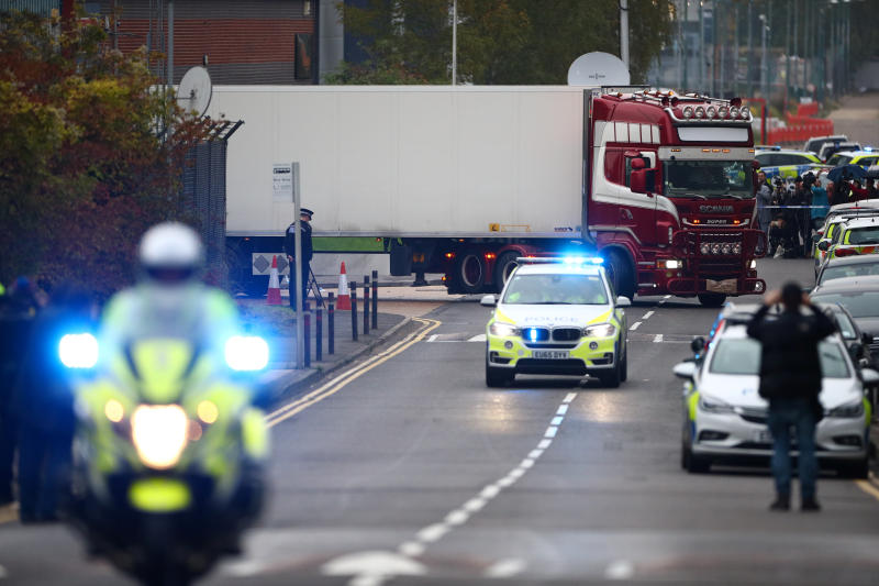Police move the lorry container where bodies were discovered, in Grays, Essex, Britain Oct 23, 2019. (Reuters file photo)