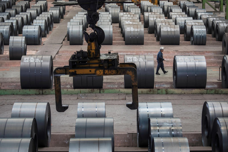 A worker walks past steel rolls at the Chongqing Iron and Steel plant in Changshou, Chongqing, China Aug 6, 2018. (Reuters file photo)