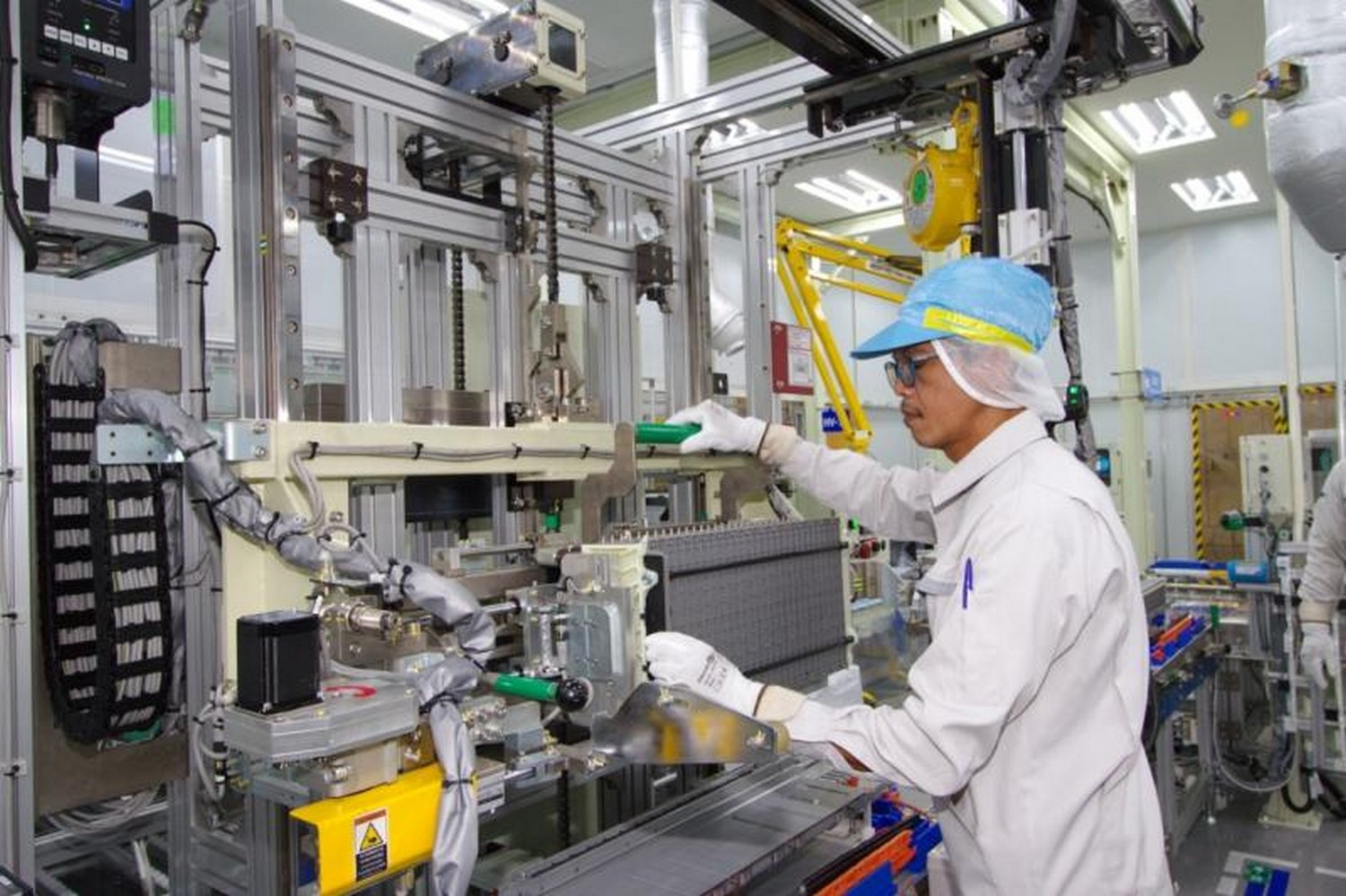 An employee at work inside an assembly plant for hybrid car batteries in Chachoengsao province opened by Toyota Motors Thailand in May 2019. (Supplied)