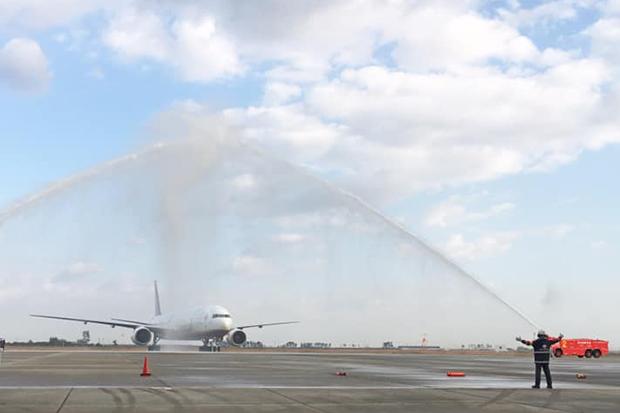 A Thai Airways International plane receives a water salute after landing at Sendai airport on Wednesday. (Sendai airport Facebook account)