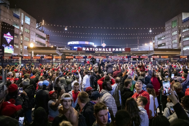 Washington Nationals pour onto the streets outside Nationals Park to celebrate their team's World Series victory