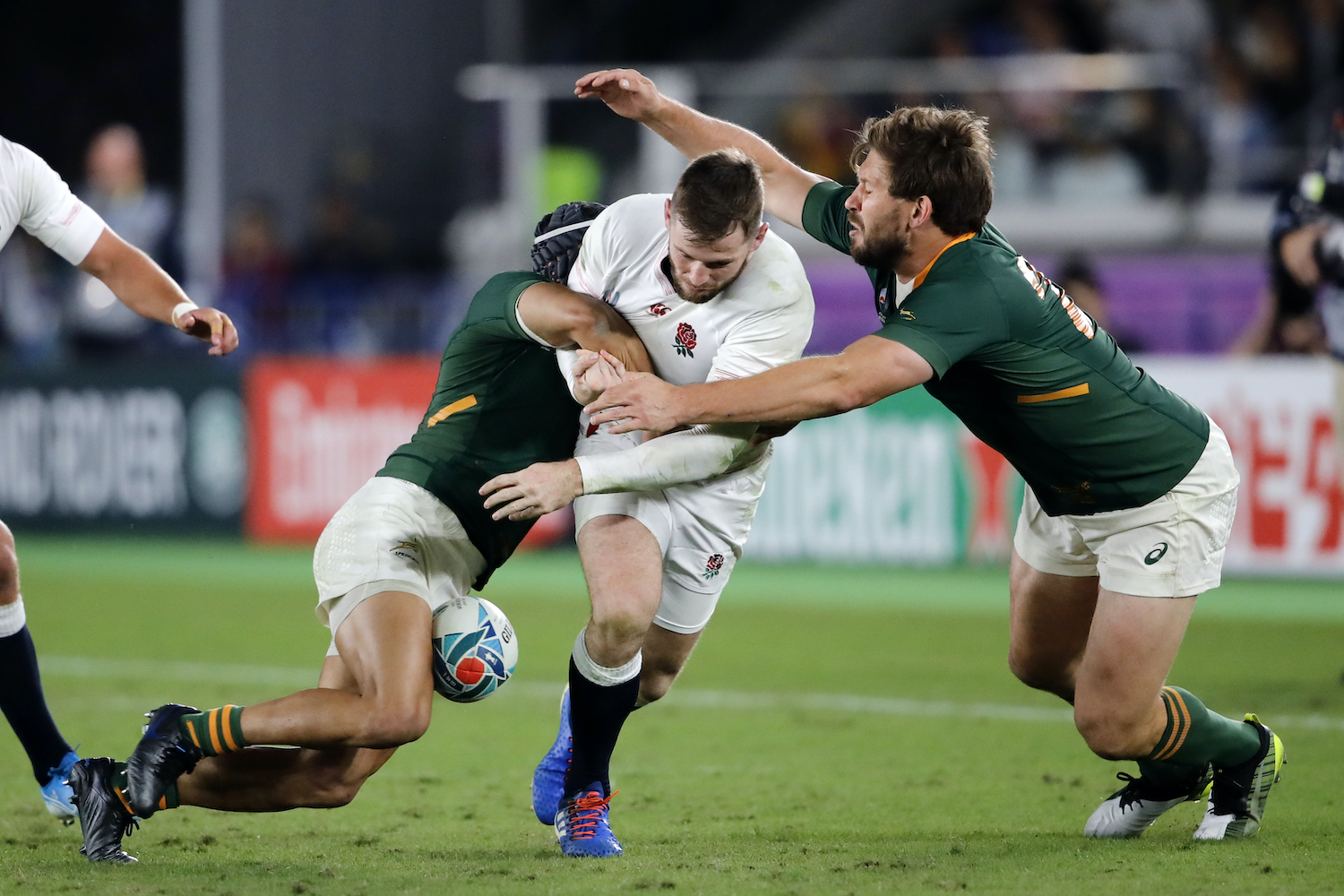 Owen Farrell England's Elliot Daly loses the ball as he is tackled by South Africa's Cheslin Kolbe (left) and Frans Steyn during the Rugby World Cup final in Yokohama on Saturday. (AP Photo)