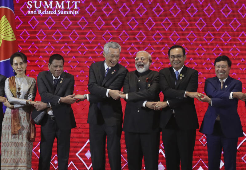 India's Prime Minister Narendra Modi, fourth left, laughs as he poses for a group photo with The Association of Southeast Asian Nations (Asean) leaders, from left, Myanmar leader Aung San Suu Kyi, Philippines President Rodrigo Duterte, Singapore Prime Minister Lee Hsien Loong, Thailand Prime Minister Prayut Chan-o-cha and Vietnam Deputy Prime Minister Phạm Binh Minh during the Asean-India summit in Nonthaburi, Thailand, on Sunday. (AP photo)