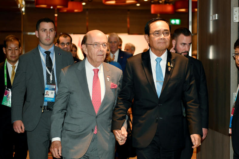 Prime Minister Prayut Chan-o-cha and US Commerce Secretary Wilbur Ross attend a bilateral meeting in Bangkok on Sunday. (Reuters photo)