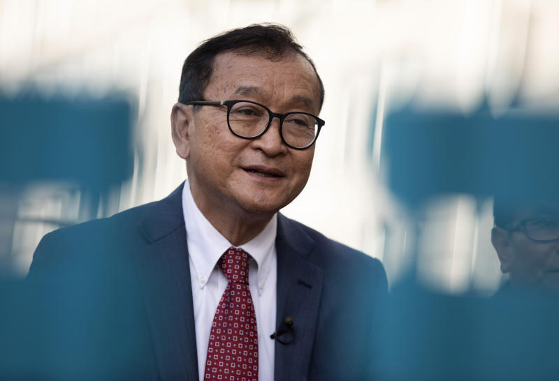 ICambodian opposition politician Sam Rainsy speaks during an interview in front of the European Parliament in Brussels on Monday. (AP photo)