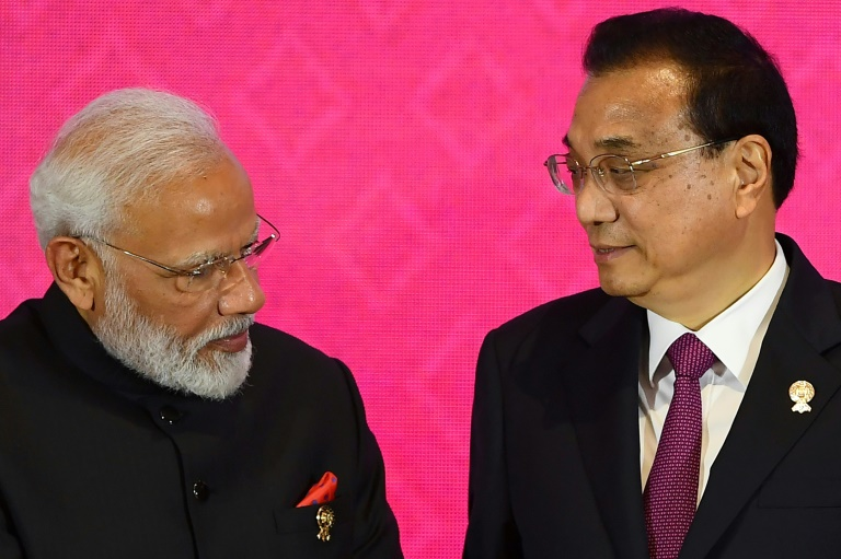 India opted not to join a major Asian trade pact over concerns about market access being hindered by cheap Chinese-made goods -- Indian Prime Minister Narendra Modi and Chinese Premier Li Keqiang are seen here at the summit in Bangkok.