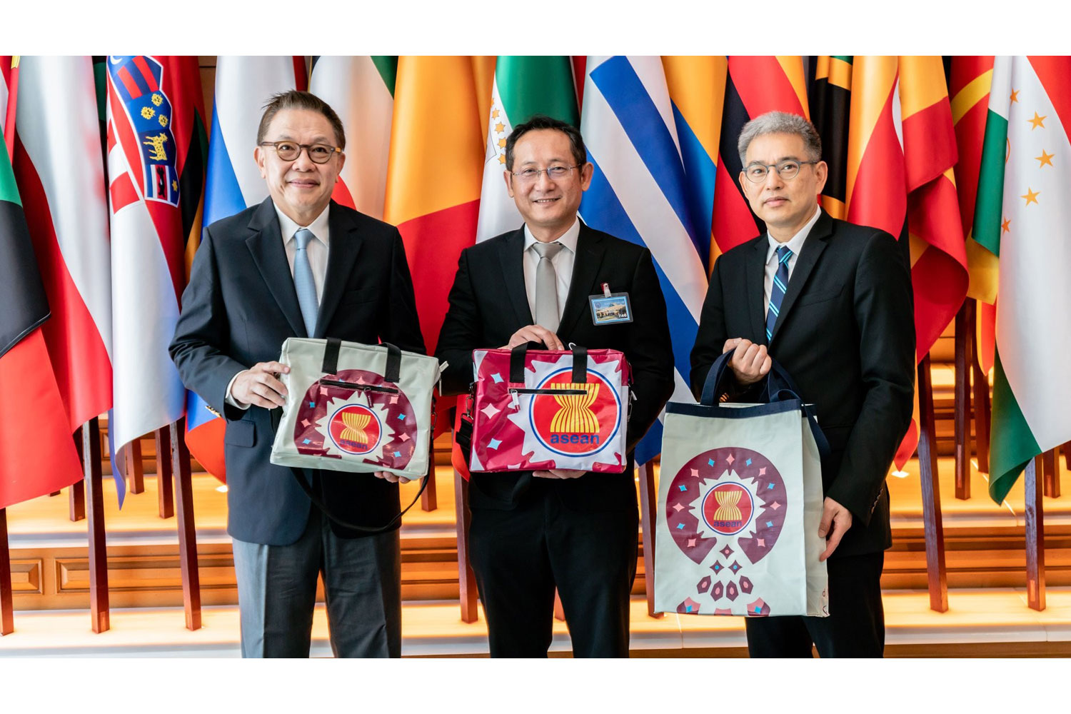 Caption: Mr. Visit Malaisirirat, CEO of Magnolia Quality Development Corporation Limited (MQDC) (center) presented upcycled bags to Mr. Tharit Charoongwat (left), Former Ambassador and Head of ASEAN Summit Operation 2019 in the Ministry of Foreign Affairs, and Mr. Jittapat Thongprasert (right), Ambassador Attached to the Ministry Office of the Permanent Secretary at the Ministry of Foreign Affairs. The bags will be presented to the heads of each national delegation at the ASEAN Summit and their partners.