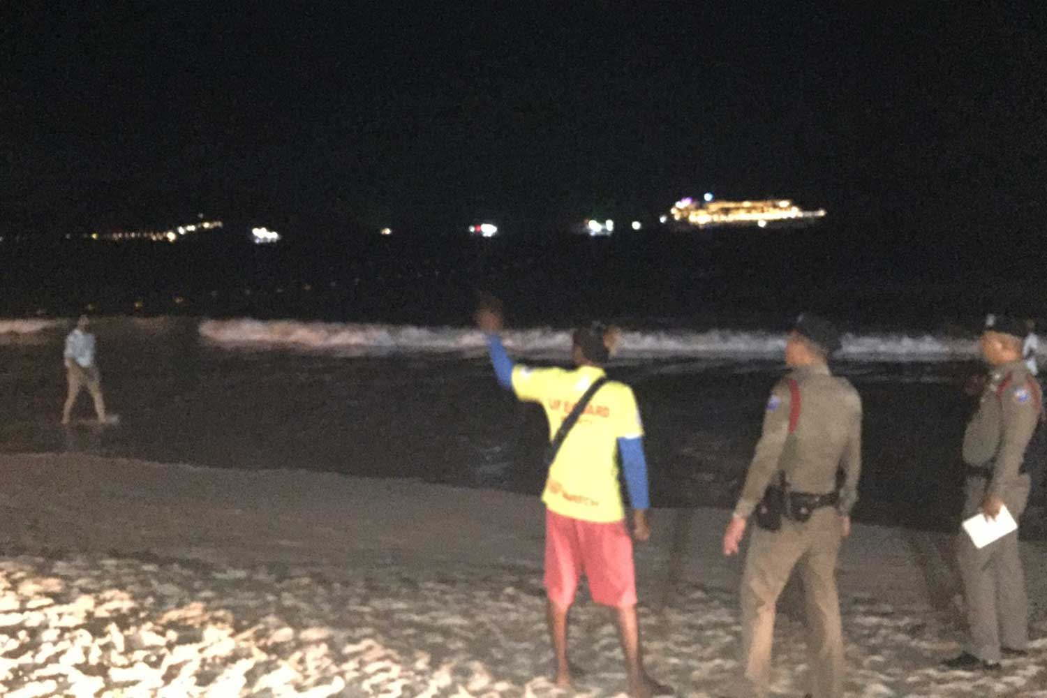 Police inspect the area where the foreign woman was found drowning and saved, on Patong beach in Phuket on Thursday morning. (Photo by Achadtaya Chuenniran)