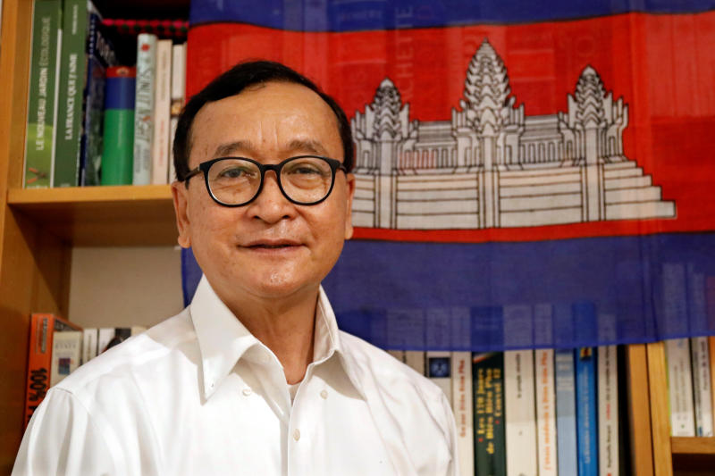 Self-exiled Cambodian opposition party founder Sam Rainsy poses prior to his departure to Bangkok on Thursday from his Paris base on Wednesday. (Reuters photo)