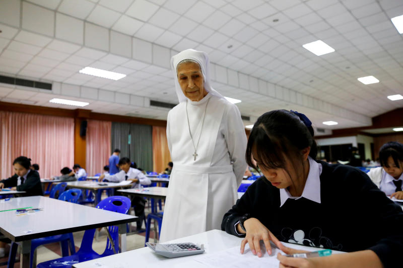 Sister Ana Rosa Sivori watches as students take an exam at St Mary School in Udon Thani province on Sept 24, 2019. (Reuters photo)