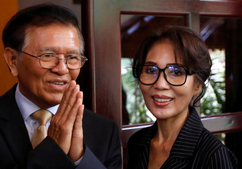 Leader of the Cambodia National Rescue Party (CNRP) Kem Sokha (left) greets media as French Ambassador to Cambodia Eva Nguyen Binhin leaves after a meeting at his home in Phnom Penh, Cambodia, on Monday. (Reuters photo)