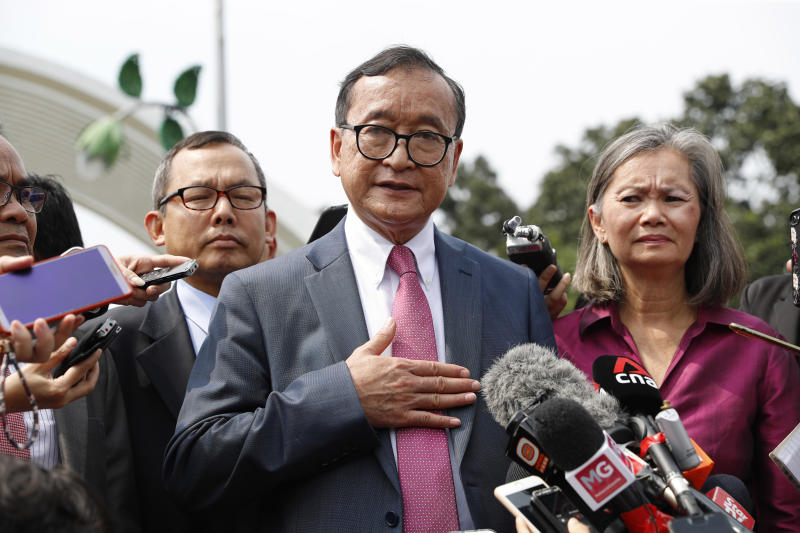 Cambodia's exiled opposition leader Sam Rainsy talks to the media outside Parliament House in Kuala Lumpur, Malaysia, on Tuesday. (AP photo)
