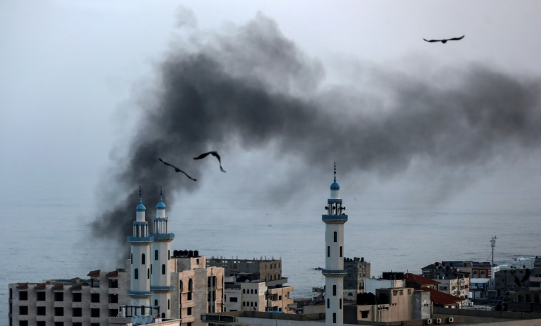 Smoke rises over Gaza City as Israel carries out a second day of air and missile strikes in response to barrages of rocket fire following its targeted killing of a top militant.