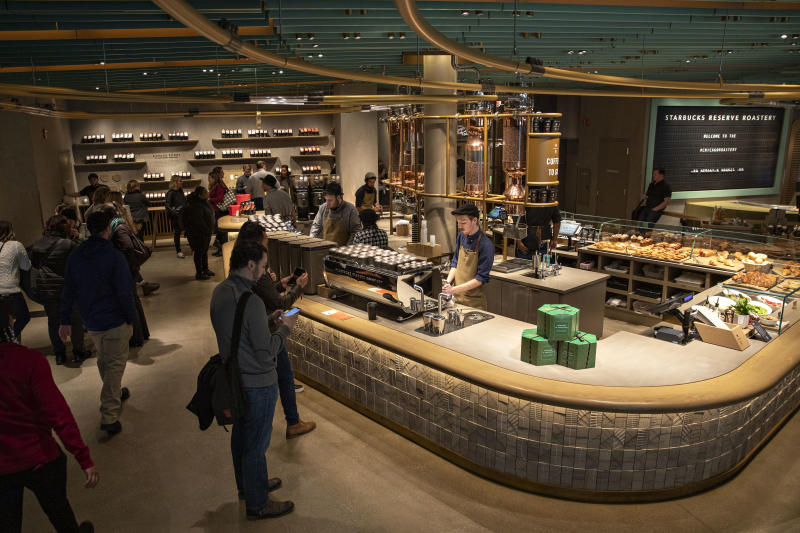 A barista prepares coffee beverages during a preview of the new Starbucks Reserve Roastery in Chicago on Tuesday. (Bloomberg photo)