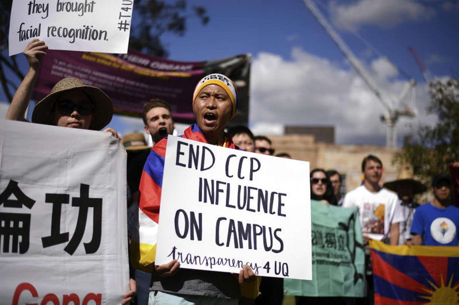 Students hold placards during a protest at the University of Queensland in Brisbane, Australia, on  July 31, against funding agreements between Australian universities and Chinese government funded education organisations. (Photo: AAP/AP)