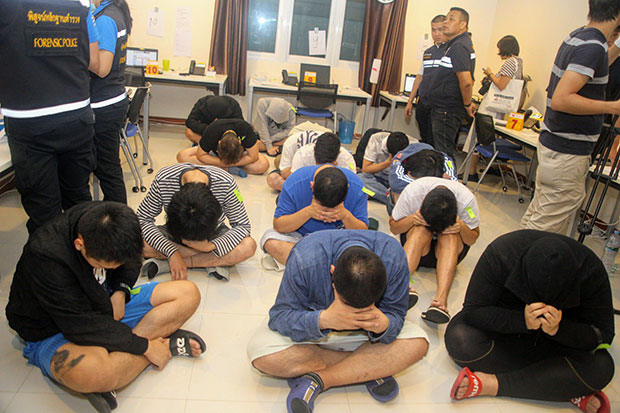 Fifteen Japanese nationals suspected of being call-centre scammers are arrested during a search in Bang Lamung district, Chon Buri, in March. Thirty-six Japanese men were detained in Manila on Wednesday on similar charges. (Photo by Chaiyot Pupattanapong)