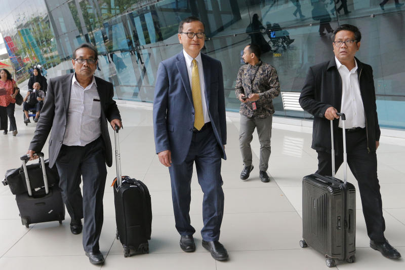 Cambodia's exiled opposition leader Sam Rainsy (centre) walks with aides upon arrival at Soekarno-Hatta airport in Tangerang, Indonesia, on Thursday. (AP photo)