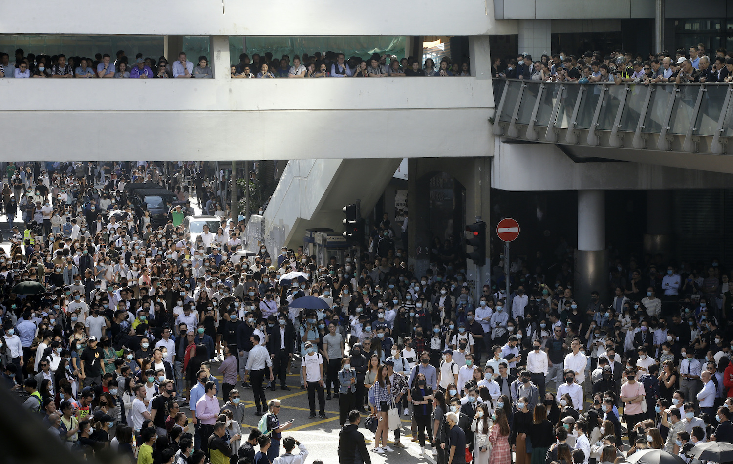 Protesters gather for a demonstration in the financial district in Hong Kong on Friday. (AP Photo)