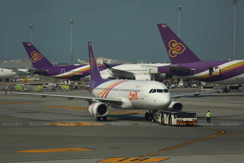 Thai Airways International and THAI Smile planes at Suvarnabhumi airport. (Bangkok Post photo)