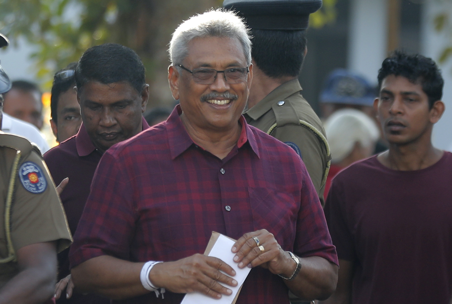 Presidential candidate Gotabaya Rajapaksa leaves a polling station after casting his vote in Embuldeniya, on the outskirts of Colombo, on Saturday. A former defence secretary in an administration headed by his brother, Mr Rajapaksa has been leading in opinion polls ahead of the vote. (AP Photo)