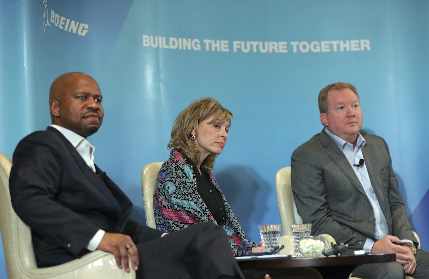 Stan Deal (right), president and CEO of Boeing Commercial Airplanes, listens to a question at a news conference on the eve of the Dubai Air Show on Saturday. Looking on are Ted Colbert, president and CEO of Boeing Global Services, and Leanne Caret, president and CEO of Boeing Defence, Space & Security. (AP Photo)