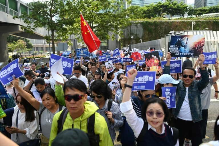 A group of around 500 people staged a rally near the government headquarters in support of the Hong Kong police force.