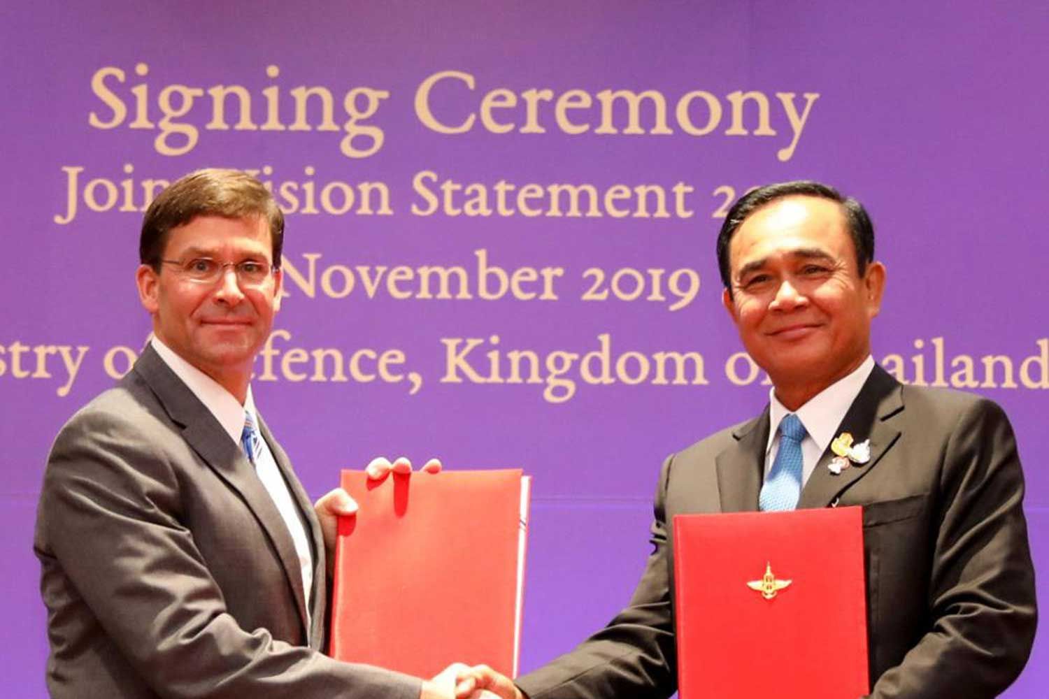 Prime Minister and Defence Minister Prayut Chan-o-cha and US Secretary of Defense Mark Esper shake hands at a ceremony to sign the Thai-US Joint Vision Statement 2020, held in Bangkok on Sunday. Photo courtesy of the US Embassy in Bangkok.