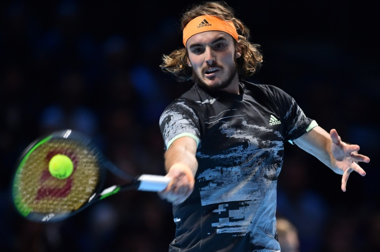 Greece's Stefanos Tsitsipas in action against Austria's Dominic Thiem during the final at the ATP Finals.