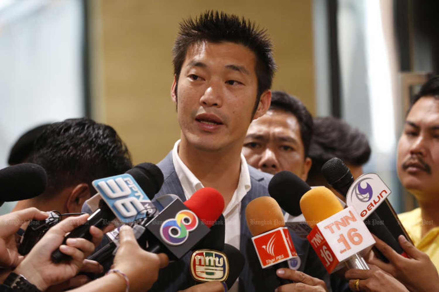 Future Forward Party leader Thanathorn Juangroongruangkit answers questions from reporters. The Election Commission on Tuesday repeated its demand for more documents from the FFP in its investigation into loans he made to the party totalling more than 100 million baht.