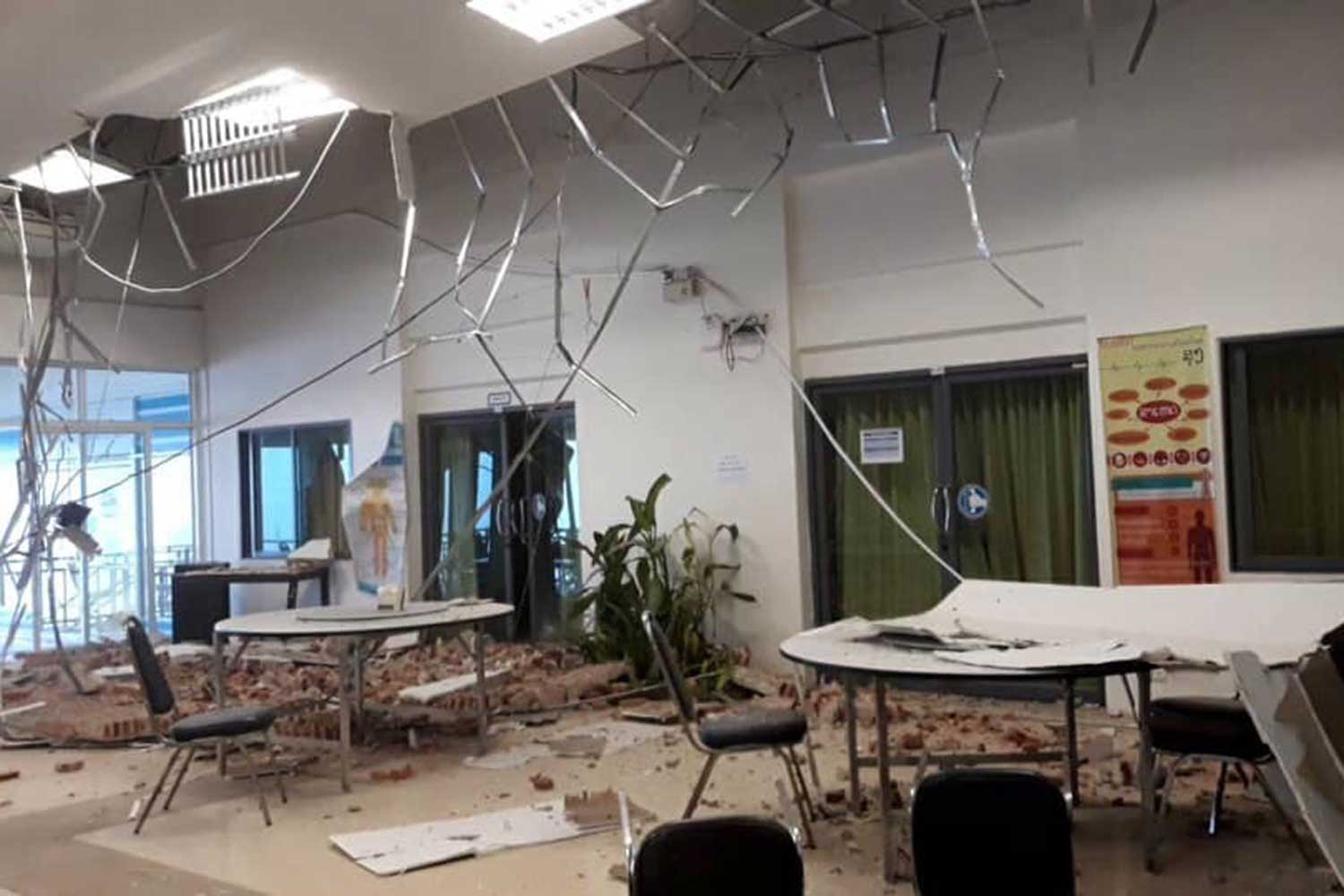 Part of the roof and ceiling collapsed at the Border Patrol Police 100th year schoool in Bo Klua district of Nan province during the earthquake on Thursday mornning. The school has been temporary closed. (Photo by Rarinthorn Petcharoen)