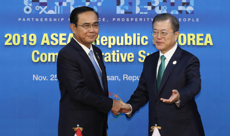South Korean President Moon Jae-in shakes hands with Prime Minister Prayut Chan-o-cha during the Asean-South Korea Commemorative Summit in Busan on Monday. (Yonhap via AP photo)