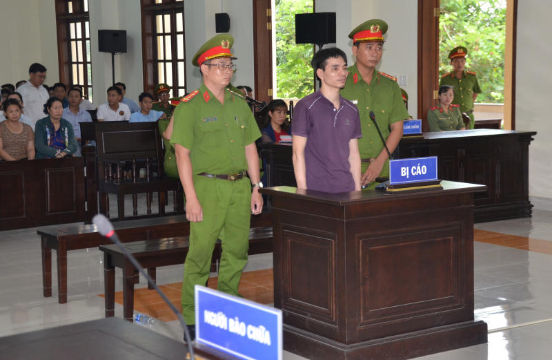 FILE PHOTO: Vietnamese Facebook user Nguyen Ngoc Anh stands between policemen during his trial at a court in Ben Tre province, Vietnam June 6, 2019. A court in Vietnam sentenced another Facebook user, Nguyen Chi Vung, to six years in prison on Tuesday. (Reuters file photo)