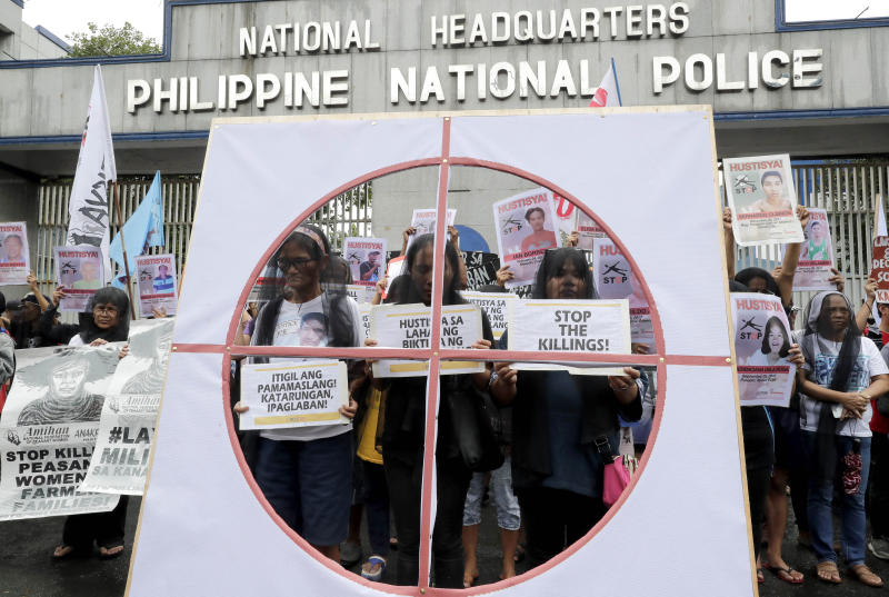 FILE PHOTO: Veiled protesters, mostly relatives of victims of alleged extra-judicial killings, display placards during a protest outside the Philippine military and police camps, following a United Nations Human Rights Council resolution in Geneva that included calls for greater scrutiny in the country in President Rodrigo Duterte's so-called war on drugs, July 17, 2019 in suburban Quezon city northeast of Manila, Philippines. (AP file photo)