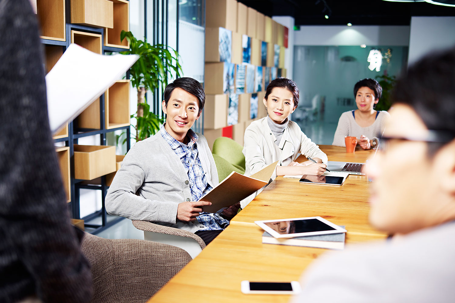 A team of young Asian entrepreneurs meet in an office to discuss ideas for new business. Entrepreneurship is viewed positively and perceived as a good career choice in Thailand.