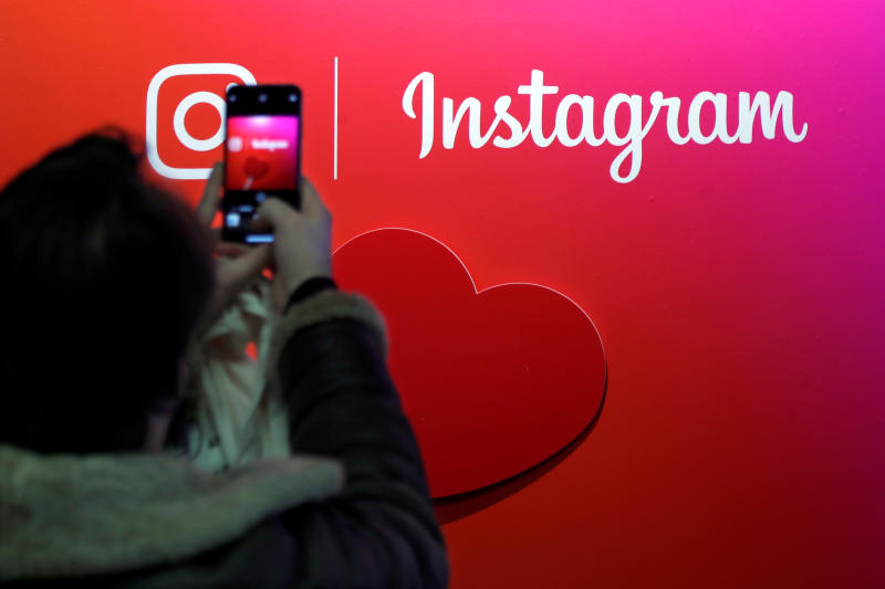 A visitor takes a picture of the Instagram application logo at the Young Entrepreneurs fair in Paris on Feb 7, 2018. (Reuters photo)