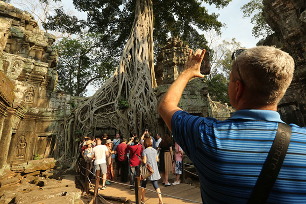 Tourists visit the Angkor Archaeological Complex in Siem Reap. (Khmer Times photo)