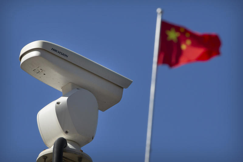 A Chinese flag flies near a Hikvision security camera monitoring a traffic intersection in Beijing, Oct 8, 2019. (AP file photo)