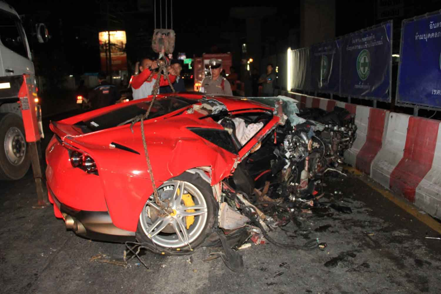 The wreckage of the crashed Ferrari, which hit a concrete barrier on Srinakarin Road in Muang district of Samut Prakan early Wednesday morning. (Photo by Sutthiwit Chayutworakan)
