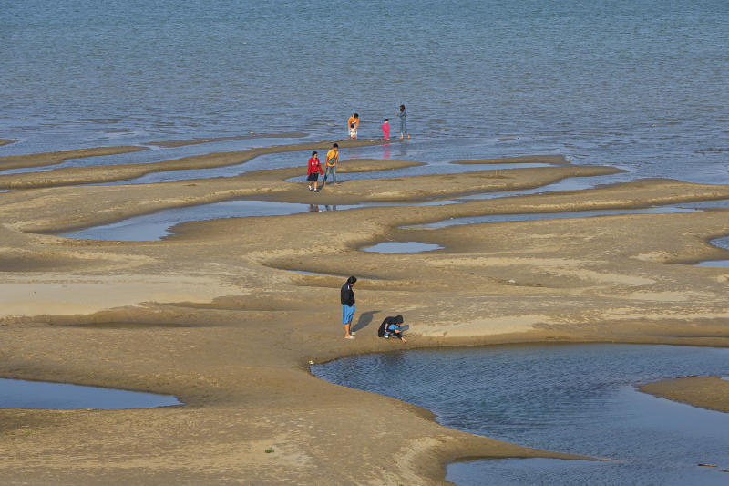 Sightseers explore a sandbar in the Mekong River in Nakhon Phanom province on Thursday. (AP photo)