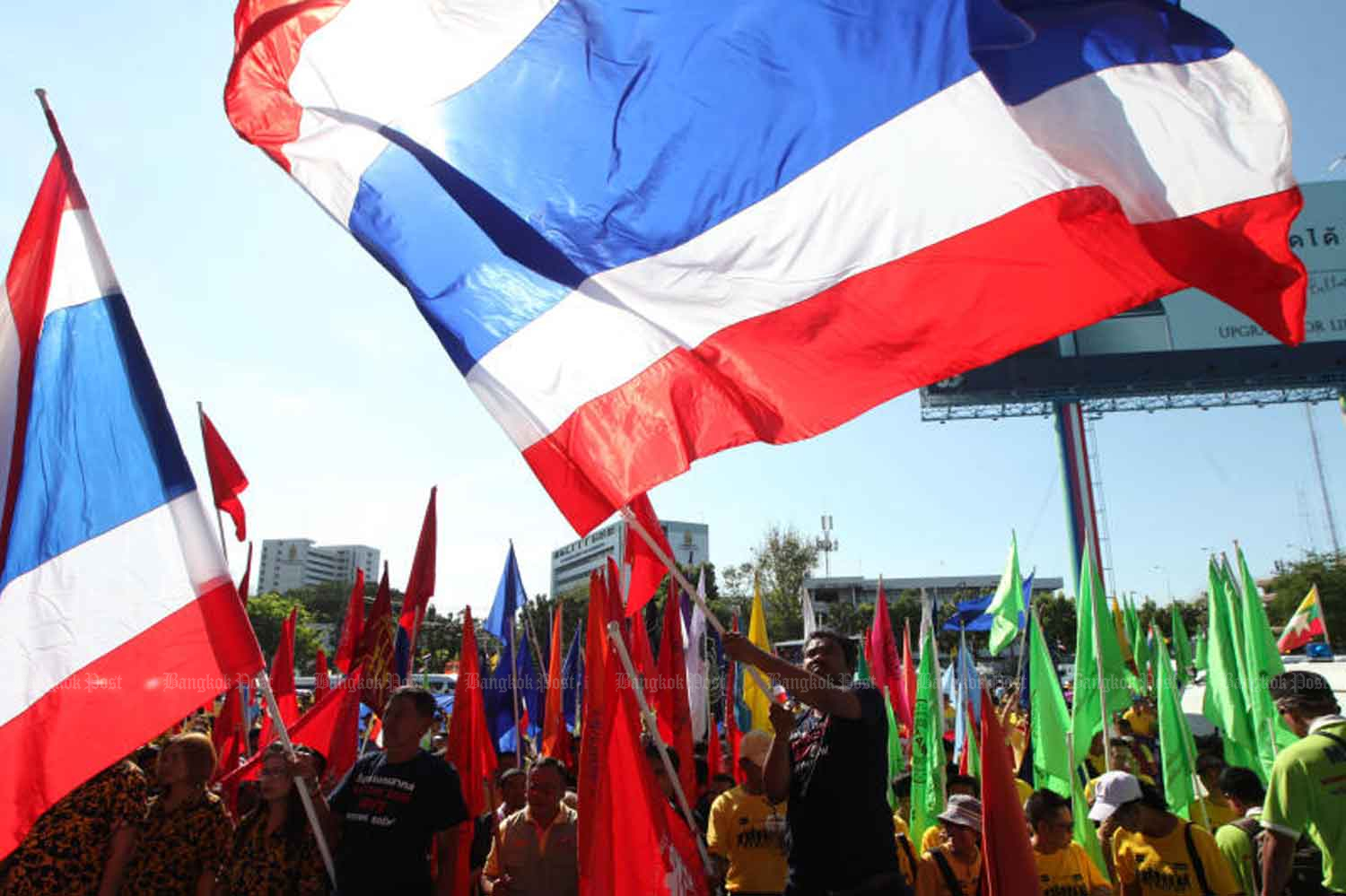Workers gather for activities marking Labour Day near the Port Authority of Thailand in Bangkok on May 1. Unskilled workers will get a small rise from Jan 1. (File photo)