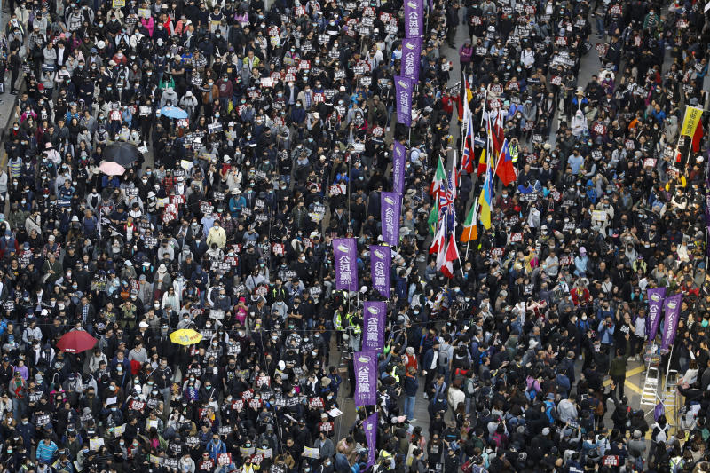 Pro-democracy protesters march on a street in Hong Kong on Sunday. (AP photo)
